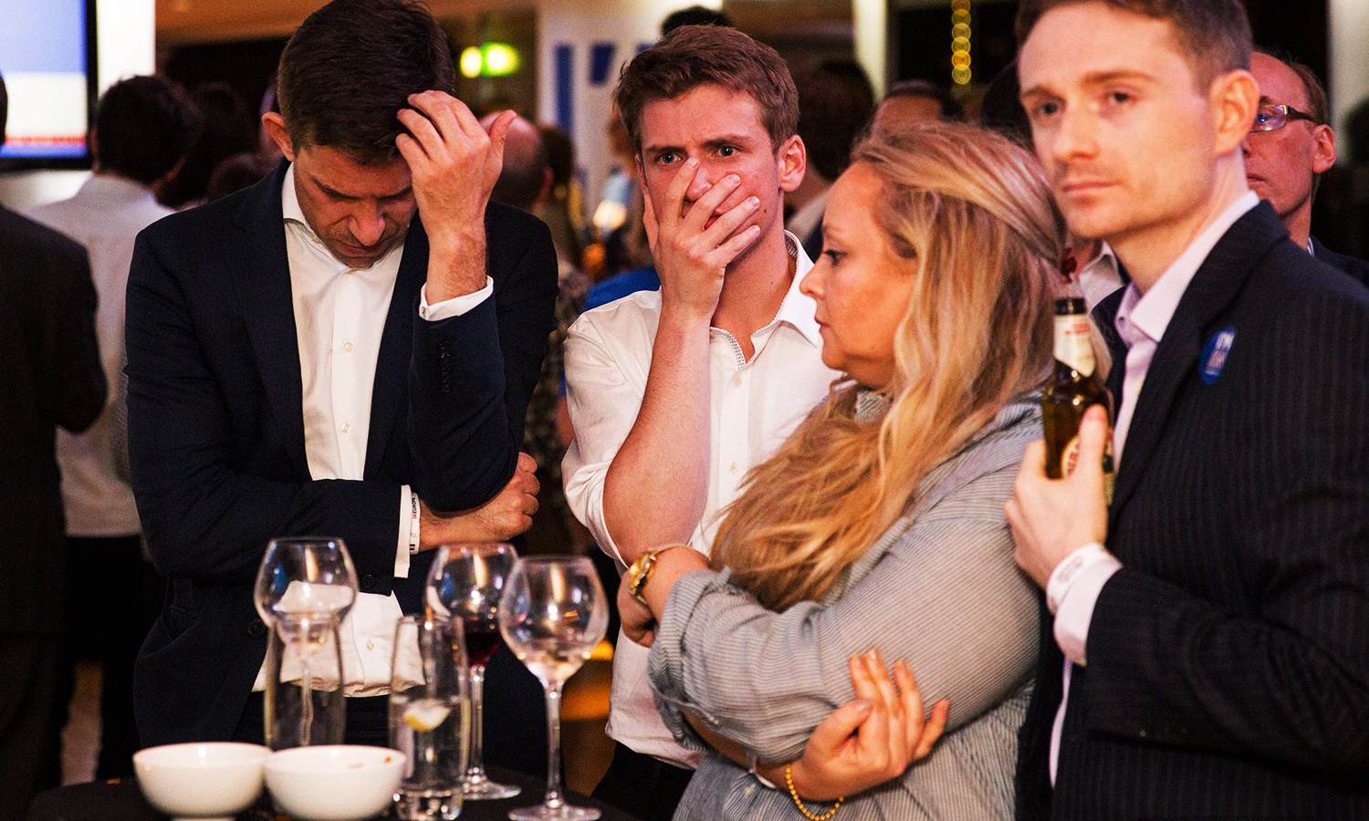 Supporters of the 'Stronger In' Campaign react as results of the EU referendum are announced at a results party at the Royal Festival Hall in London on June 23, 2016. Bookmakers dramatically reversed the odds on Britain leaving the European Union on Friday as early results from a historic referendum pointed to strong support for a Brexit. / AFP PHOTO / POOL / ROB STOTHARD