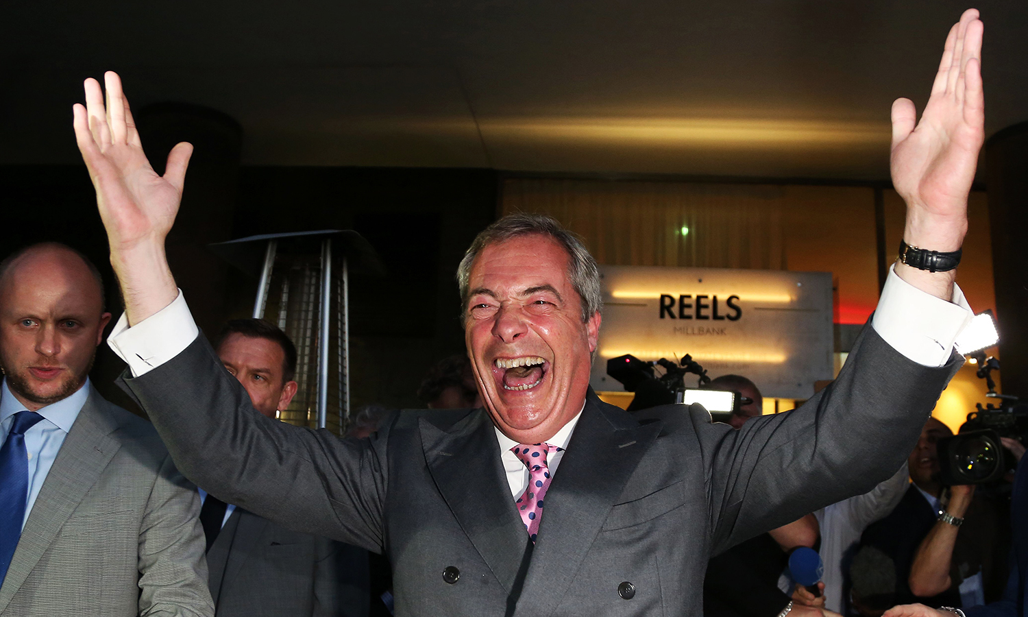 """Leader of the United Kingdom Independence Party (UKIP), Nigel Farage reacts at the Leave.EU referendum party at Millbank Tower in central London on June 24, 2016, as results indicate that it looks likely the UK will leave the European Union (EU). Top anti-EU campaigner Nigel Farage said he was increasingly confident of victory in Britain's EU referendum on Friday, voicing hope that the result """"brings down"""" the European Union. / AFP PHOTO / GEOFF CADDICK"""