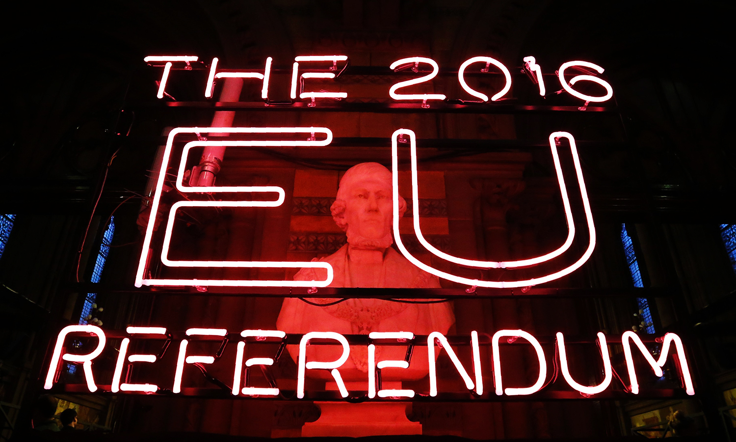 A neon sign for the 2016 referendum is attached to the doors of the announcement hall in Manchester Town Hall , northwest England on June 23, 2016 where the final result of a referendum on whether the UK will remain or stay in the European Union (EU) will be announced. Britain has voted to leave the European Union by 52 percent to 48 percent, the BBC reported on Friday, after nearly all the results had been counted. / AFP PHOTO / POOL / Rob Stothard