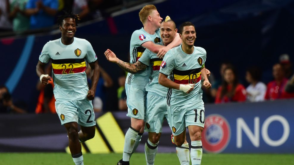 Belgium's forward Eden Hazard (R) celebrates with teammates after scoring his team's third goal  during the Euro 2016 round of 16 football match between Hungary and Belgium at the Stadium Municipal in Toulouse on June 26, 2016.   / AFP / Attila KISBENEDEK        (Photo credit should read ATTILA KISBENEDEK/AFP/Getty Images)