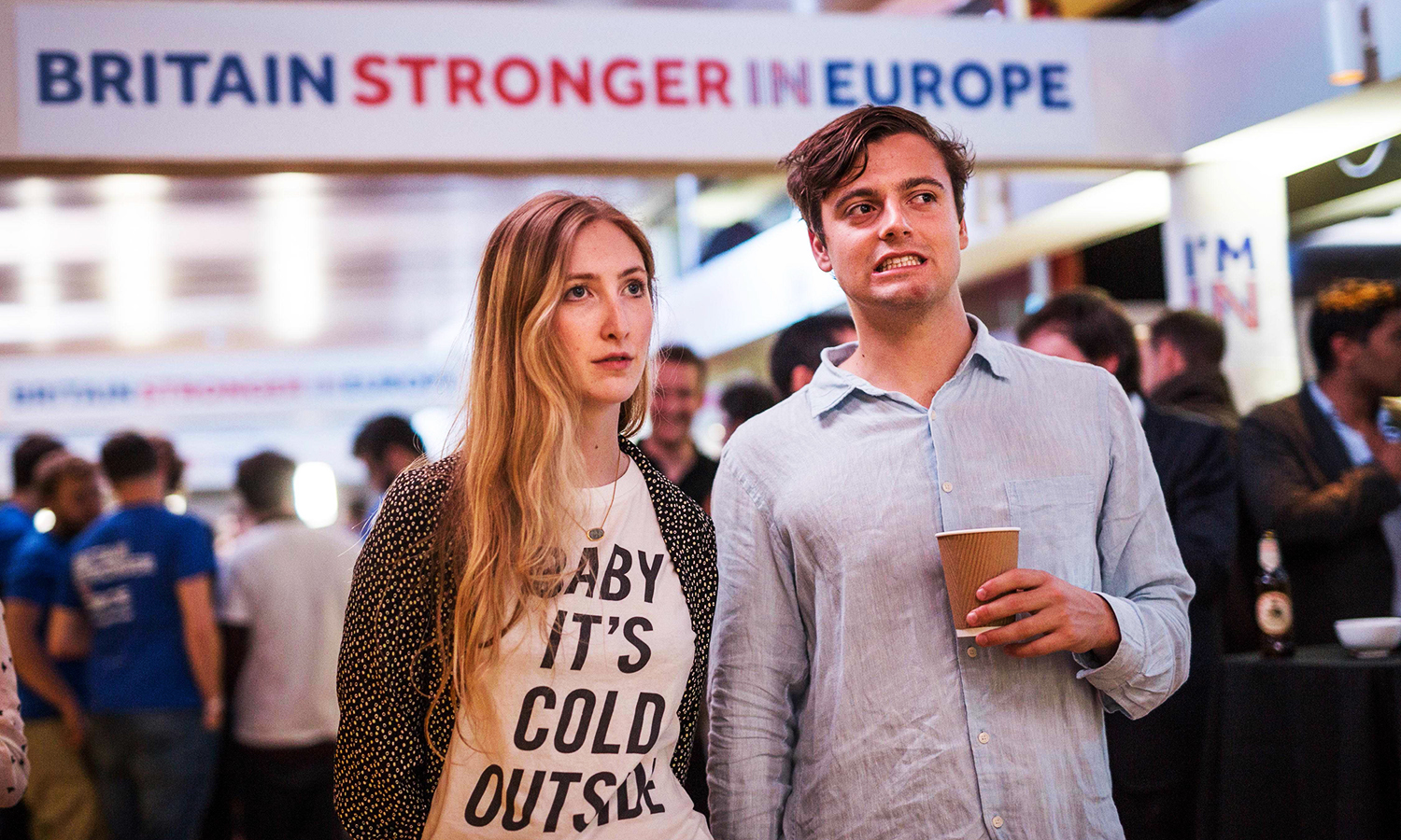 Supporters of the 'Stronger In' Campaign react as results of the EU referendum are announced at a results party at the Royal Festival Hall in London early in the morning of June 24, 2016. Bookmakers dramatically reversed the odds on Britain leaving the European Union on Friday as early results from a historic referendum pointed to strong support for a Brexit. / AFP PHOTO / POOL / ROB STOTHARD