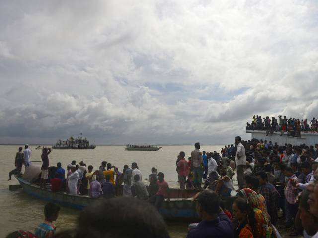 At least 13 dead after Bangladesh ferry capsizes