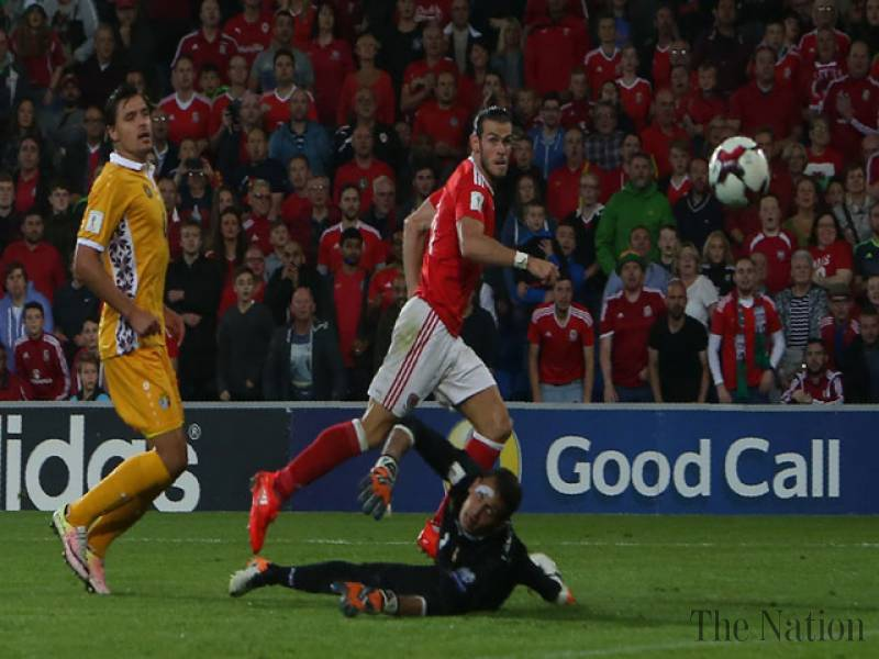 Spain and Wales cruise, Kosovo earn historic draw