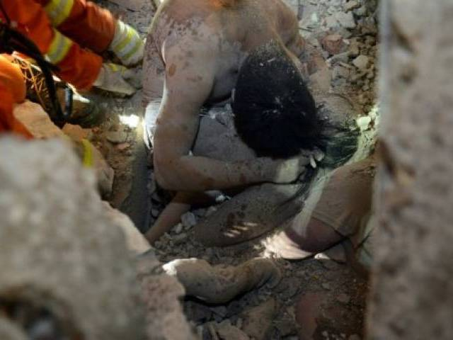 Father's last embrace saves girl in China building collapse